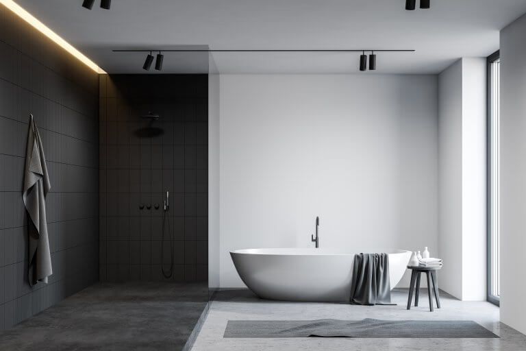 Interior of spacious loft bathroom with white and grey tiled walls, comfortable bathtub and shower stall with glass wall. Concept of spa. 3d rendering